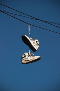 Why do you see pairs of shoes hanging from power lines?